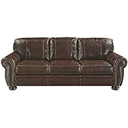Ashley Furniture Signature Design - Banner Traditional Style Faux Leather Sofa with Nailhead Trim - Coffee