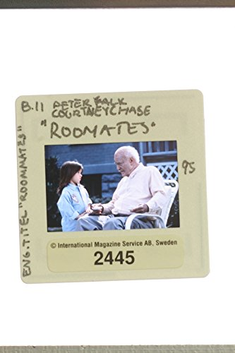 """Slides photo of Peter Falk and Courtney Chase in """"Roommates"""" (1995 fade away)."""