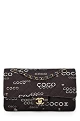 Iconic Classic Double Flap shoulder bag rendered in black quilted canvas featuring 'Coco' lettering in white, and accented with gold-tone hardware. About the Classic Flap: Few bags can claim that they have grown in popularity (and value) sinc...
