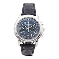 Patek Philippe Complications Chronograph (5070P001) manual-wind watch features a 42mm platinum case surrounding a blue dial on a blue alligator strap with a platinumCalatrava Cross deployant buckle. Functions include hours minutes small-seco...