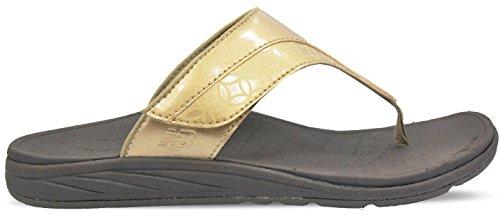 New Balance women's RevitalignRX Thrive Slide Sandal,Gold...
