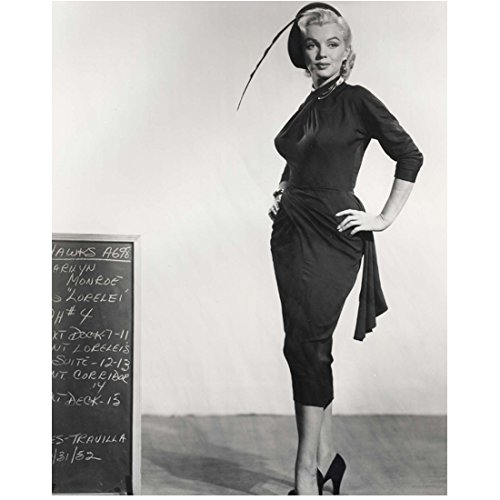 Marilyn Monroe 8 Inch x10 Inch Photo Some Like It Hot The Seven Year Itch Gentlemen Prefer Blondes B&W Clingy Dress Very Long Feather on Hat Next to Chalkboard Both Hands on Hips kn