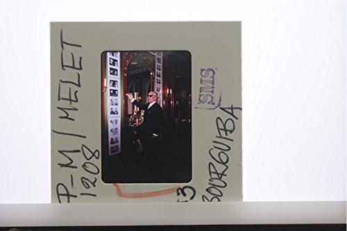 slides-photo-of-habib-bourguiba-pointing-towards-photographs
