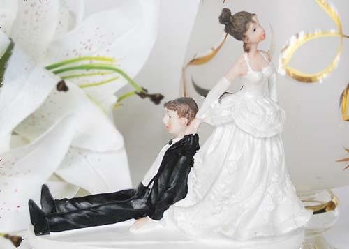 - Bride Pulling the Drunk Groom Cake Top Centerpiece
