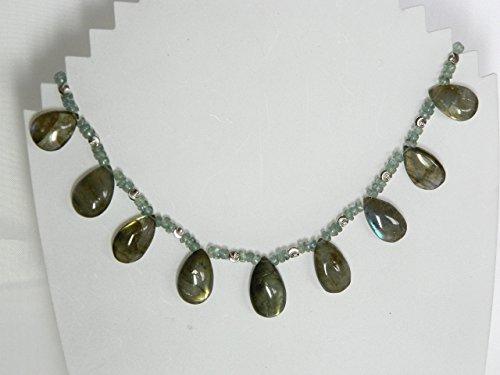 - Labradorite, peridot, and diamond laser cut sterling silver beads