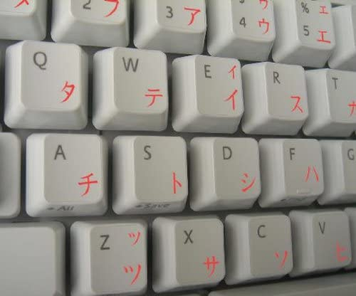 JAPANESE KATAKANA KEYBOARD STICKER WITH RED LETTERING ON TRANSPARENT BACKGROUND