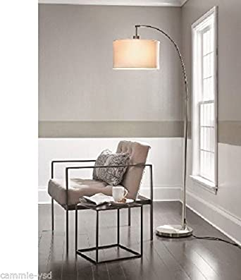 black rain drop arc floor lamp over dining table threshold brushed silver