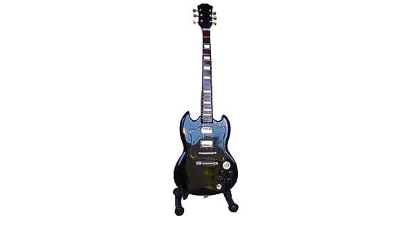 Guitarra eléctrica SG BLACK de ferrocarril - Madera barnizado - Objeto de decoración - regalo música - incluye soporte: Amazon.es: Hogar