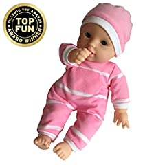 Dolly, is cuddly soft, precious and sure to be played with for years. Your little one will be captivated. Dressed in a onesie and a sweet little cap, this doll is made for love. Made for toddlers 18 months and up, a perfect first doll. The he...