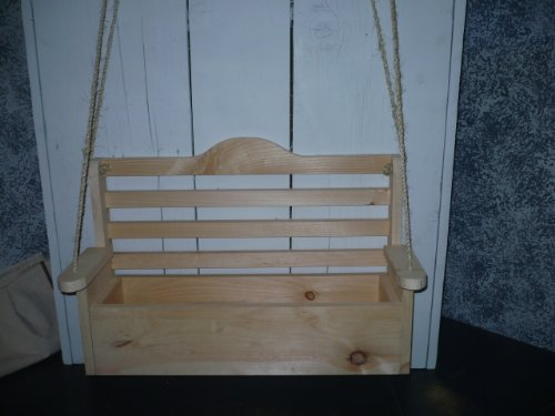 Unfinished Swing Planter. What an Darling Way to Enhance the Beauty on Your Porch with This Wooden Swing Planter. Nothing Says Spring Better Than Flowers and This Unique Handcrafted Swing Planter Will Have All Your Friends Talking. Measures: 24 1/2