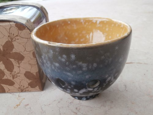Exquisite Tea Cup Ocarina Alto C, A piece of art and also an ocarina instrument. Dark Blue & w. visible diffused snow flak all around the outside body area. Inside cup is earthen yellow w. snow flake also same pattern (Earthen Patterns)