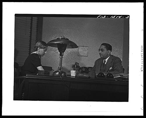 Reproduced Photo of Mr. Albert W. Williams, president of the Unity Life Insurance Company, dictating to secretary DeAcklin. Mr. Williams was born in Georgia, studied at the Univ 1942 Delano C Jack 07a