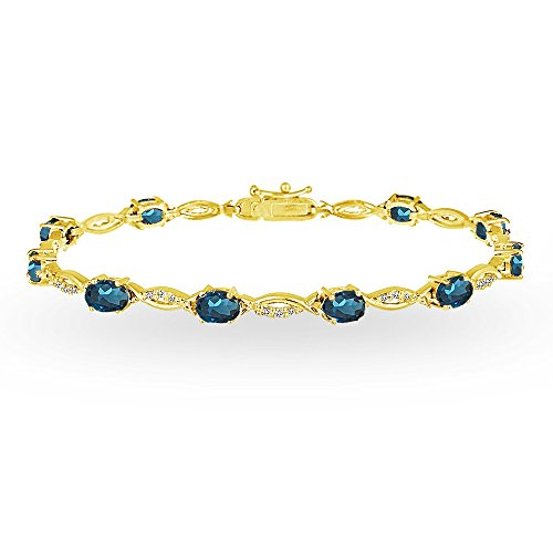 GemStar USA Yellow Gold Flashed Sterling Silver London Blue and White Topaz Oval-Cut Swirl Tennis Bracelet