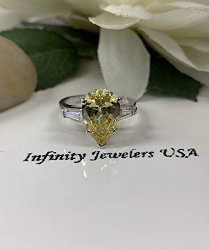 Canary yellow pear shape with 2 sides baguette engagement ring (Sides Baguette Ring)