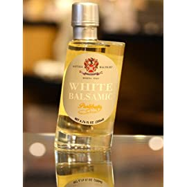 Malpighi Prelibato White Dressing - 6.7oz. Bottle 1 Prelibato is an authentic traditional white balsamic vinegar from Modena, Italy. This product is an equally delicious alternative to the traditional dark balsamic and boosts a truly unique flavor. Its delicate, creamy essence makes it an ideal condiment when drizzled over seafood and fresh fruit. Add it to your favorite meal today to get a gentle, smooth and unforgettable dish!