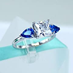 Metal: 925 Sterling Silver , Platinum Plated || Band Width: 2MM || Main Stone: AAA Cubic Zirconia / Simulated Diamond || Main Stone Color: White || Side Stone Color: Blue || Main Stone Shape: Princess / Square Cut || Main Stone Size: 2 Carat ...