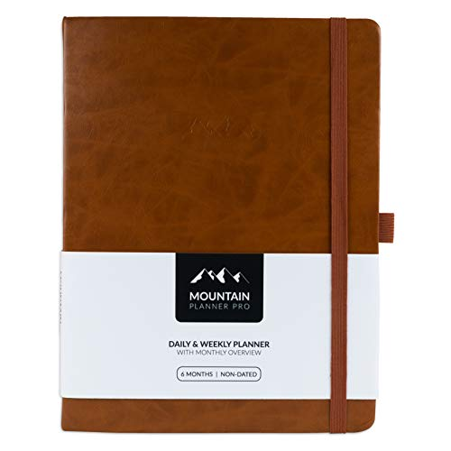 Mountain Daily Planner Pro - Large Undated Daily, Weekly Gratitude Journal and Monthly Calendar. Increase Productivity, Track Budget, Tasks and Goals in 2019. Hardcover, Pen Holder. 6 Months. Tan