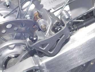 Caliper Guard Rear (93-02 YAMAHA YZ250: Works Connection Rear Brake Caliper Guard (NATURAL))