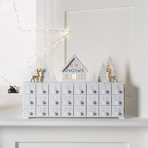 Santa's Workshop Advent Calendar made from white wood with lights