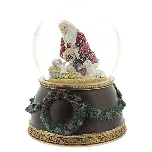 - Kneeling Santa Baby Jesus 6 Inch Holiday Water Globe Plays Tune Silent Night