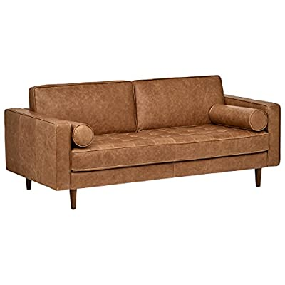 "Amazon Brand – Rivet Aiden Tufted Mid-Century Modern Leather Loveseat Sofa, 74""W, Cognac - This sleek, mid-Century inspired leather sofa is designed to impress. A tufted bench seat cushion, plush back cushions, tapered wood legs, and tidy bolster pillows provide just the right mix of comfort and contemporary edge. 74''W x 36.2""D x 30.3""H; seat height 17.7""; seat depth 23.2"" Solid hardwood frame, tapered wood legs and foam padding with top grain leather upholstery. - sofas-couches, living-room-furniture, living-room - 41Y%2B778IqiL. SS400  -"