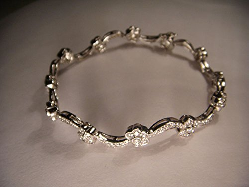 - Exquisite Estate 18K White Gold Diamond Floral Tennis Bracelet