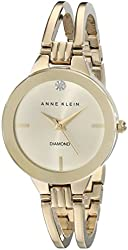 Anne Klein Women's AK/1942CHGB Diamond-Accented Dial Gold-Tone Bangle Watch