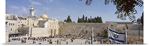 Great Big Canvas Poster Print entitled Crowd praying in front of a stone wall