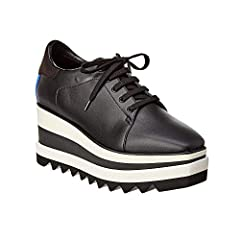 New sporty twist on a classic; the Sneak-Elyse in Black with contrasting white and black rubber saw-edge sole.