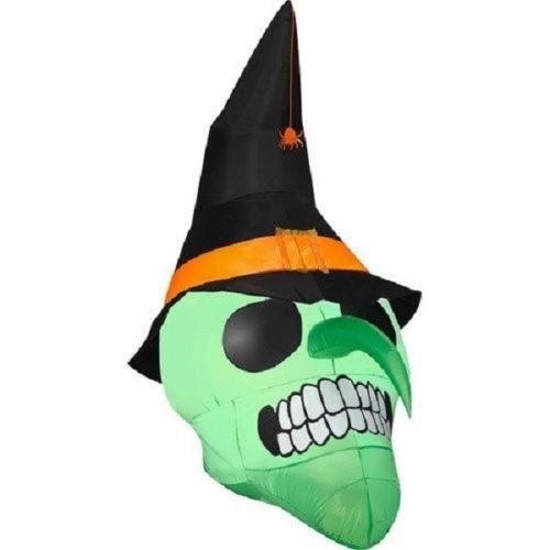 Gemmy Airblown Inflatable Green Skull Wearing Witch Hat with a Spider Hanging - Holiday Decoration, 6-foot Tall x 3.5-foot Wide x 5-foot Deep]()