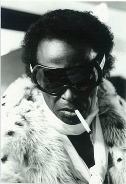 Photo Miles Davis in fur, scarf, and superfly eyewear,