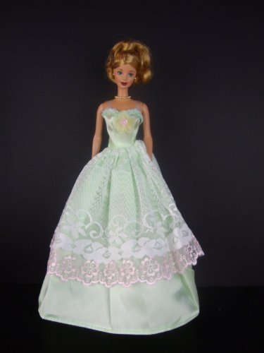 A Green Gown with White Lace Trim and a Flower Motif on the Lace Made to Fit the Barbie Doll ()