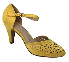 50's inspired ladies pumps. Vintage feel, feminine style. All day comfort with padded insole, low kitten heel. Secure fit with over the arch ankle strap. Delicate feminine perforated perf cut-outs.
