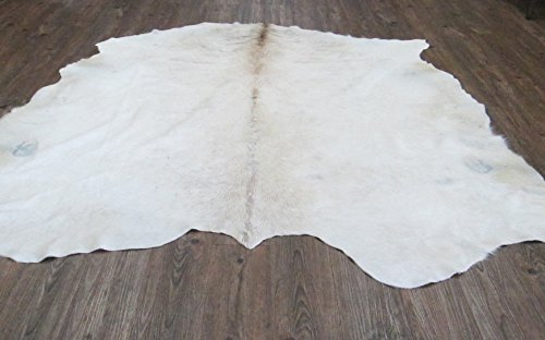 - 100% real Cowhide Area Rug made in Brazil Natiral dye Solid White CowHide Area Rug Make In Brazil size on Average 6' x 7' Feet