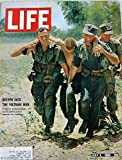 LIFE Magazine  ~  July 2, 1965;  Cover Story:  Deeper Into the Vietnam War: A Marine is Evacuated During Partol Action....
