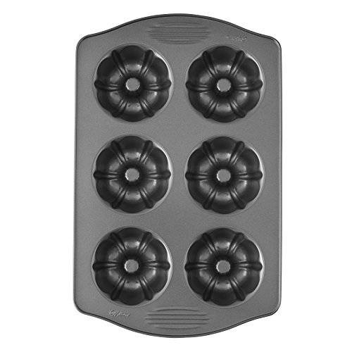 Wilton Excelle Elite Mini Fluted Tube Cake Pan, 6-Cavity]()