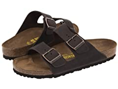 The BIRKENSTOCK Arizona is a genuine classic. This individually adjustable unisex two- strap sandal is now available in a uniquely sophisticated nubuck leather version. The leather features an open selvedge finish, emphasizing the handcrafted...