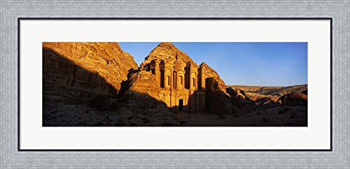 Deep shadows at the monastery, Al Deir Temple, Wadi Musa, Petra, Jordan by Panoramic Images Framed Art Print Wall Picture, Flat Silver Frame, 35 x 17 ()