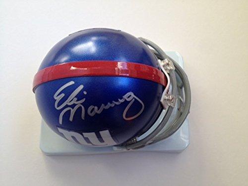 - Giants Eli Manning autographed mini helmet Mounted Memories