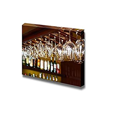 Empty Glasses for Wine Above a Bar Rack 32