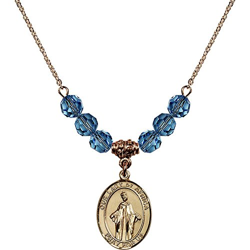 18-Inch Hamilton Gold Plated Necklace with 6mm Blue March Birth Month Stone Beads and Our Lady of Africa Charm by Bonyak Jewelry