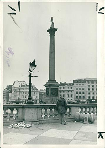 Vintage photo of A lamp leans drunkenly near to a broken bollard in Trafalgar Square.