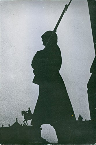 Vintage photo of German guard standing and looking at something.