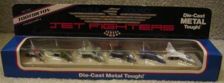 (TOOTSIETOY EAGLE SQUAD DIE-CAST METAL TOUGH JET FIGHTERS-INCLUDES F-15 EAGE,F-16 FALCON,F-4 PHANTOM,STEALTHFIGHTER,F-106 DELTA DART,F-14 TOMCAT-MANUFACTURED IN 1988)