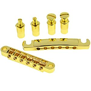 a set of gold roller saddle tune o matic guitar bridge tailpiece for lp electric. Black Bedroom Furniture Sets. Home Design Ideas