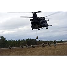 U.S. Soldiers with the 7th Special Forces Group fast rope out of a CH-47 Chinook Poster Print (34 x 22)