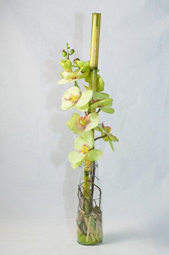 Orquídeas verdes en una botella de leche - pieza central, arreglo floral con flores artificiales