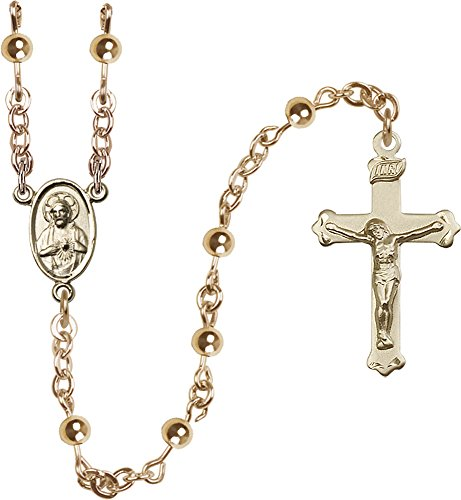 F A Dumont 14kt Gold Filled Rosary features 5mm Gold Filled Mother of Pearl beads. The Crucifix measures 1 1/8 x 5/8. The centerpiece features a Scapular medal.