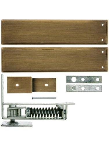 Standard Duty Swinging Door Floor Hinge with Plated-Steel Cover Plates in Antique Brass
