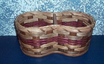 Amish Handmade Home and Garden Peanut Basket. This Handmade Basket Was Designed to Put Nuts in One Side and Empty the Shells in the Other Side. This Basket Is in the Shape of a Peanut and Will Make a Great Conversation Piece. Colors May Vary (Black, Red, Blue, Green, Burgundy, Natural)measures: 10